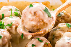 Swedish homemade meatballs smothered in a creamy gravy sauce, ma Royalty Free Stock Image