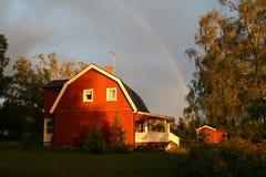 Swedish house with rainbow Stock Image