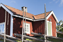 Swedish house. A traditional Swedish house behind an old wooden fence Royalty Free Stock Photos