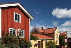 Swedish houses with blue sky. Swedish wood houses in red and yellow with blue sky Stock Images