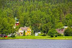 Swedish houses near lake Stock Image