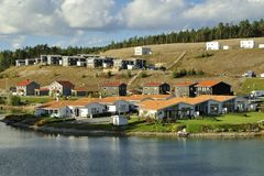 Swedish housing. Homes with Pond. Scene of prime real estate community. Living in serenity Royalty Free Stock Photo