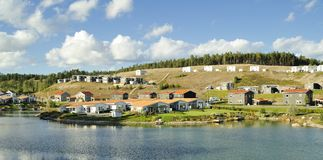Swedish housing. Homes with Pond. Scene of prime real estate community. Living in serenity Royalty Free Stock Images