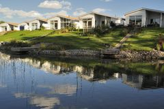 Swedish housing. Homes with Pond. Scene of prime real estate community. Living in serenity Stock Photography