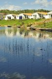 Swedish housing. Homes with Pond. Scene of prime real estate community. Living in serenity Stock Photos