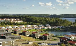 Swedish housing. Homes with Pond. Scene of prime real estate community. Living in serenity Stock Image