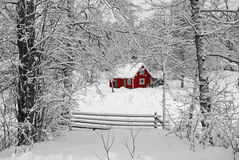 Swedish idyllic red house. Red Swedish cottage in winter landscape Stock Photography