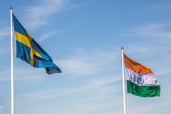 Swedish and Indian Flag. Waving in Front of a Cloudy Blue Sky Stock Photos