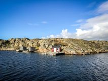 Rocky island with a nice red house Royalty Free Stock Photo