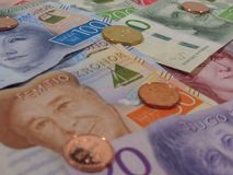 Swedish Krona notes and coins, Sweden. Swedish Krona banknotes and coins SEK, currency of Sweden Stock Photography