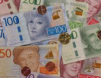 Swedish Krona notes and coins, Sweden. Swedish Krona banknotes and coins SEK, currency of Sweden Royalty Free Stock Photos