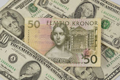 Swedish krona surrounded by United States dollars Royalty Free Stock Image