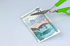 Swedish krona. sweden's currency. Swedish krona, the currency of sweden. with scissors. duties and taxes Stock Photography