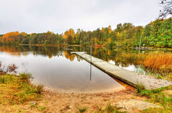 Swedish lake beach in autumn Stock Image