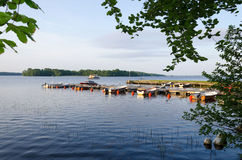 Swedish lake boat harbor. Swedish small boats harbor in morning light Royalty Free Stock Images