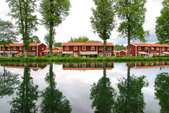 Swedish lakeside on a warm summer evening. Swedish red house lakeside on a warm summer evening stock photos