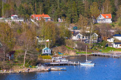 Swedish landscape, coastal village, pier Stock Photo