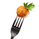 Swedish meatball. A picture of traditional Swedish meatball on a fork over white background Royalty Free Stock Images