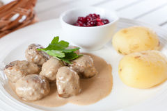 Swedish meatballs. Swedish traditional meatballs served with fresh potatoes, brown gravy, vegetables and lingonberry jam Royalty Free Stock Photos