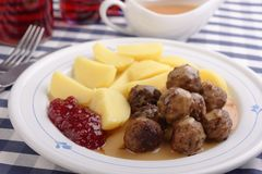 Swedish meatballs with boiled potato and jam. Swedish meatballs with boiled potato, lingonberry jam, and cream sauce Royalty Free Stock Photo