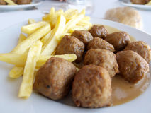 Swedish Meatballs Closeup. Closeup of Swedish meatballs with chips potatoes (French fries) and sauce Stock Images