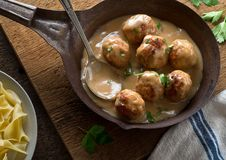 Swedish Meatballs. Delicious homemade swedish meatballs with mushroom cream sauce and egg noodle royalty free stock images
