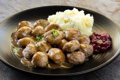 Swedish Meatballs with Lingonberry on Black Plate over Slate Stock Images