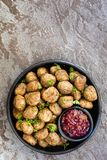 Swedish Meatballs with Lingonberry on Black Plate over Slate Royalty Free Stock Photo