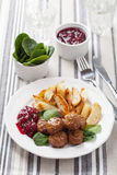 Swedish meatballs with potatoes and lingon jam Stock Photo