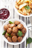 Swedish meatballs with potatoes and lingon jam Stock Photos
