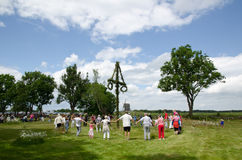 Swedish midsummer dancing. Around a midsummer tree to celebrate the summer Royalty Free Stock Image