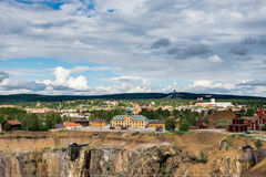 Swedish Mining Town Falun. View of the Swedish mining town Falun. Home of the largest copper mine in Sweden with the great shaft in front and the ski jumping Stock Image