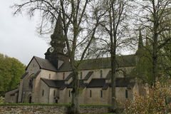 A Swedish Monastery called Varnhem. A picture of Varnhem Monastery in Sweden with a view of the steeples and the façade of building, with trees and a stone stock photo