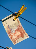 Swedish money on clothesline Royalty Free Stock Image