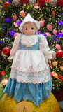 Swedish national custome. A doll dressed in Swedish national custome with the Christmas tree and Christmas balls in the background.  Photo taken on November 14th Royalty Free Stock Photography