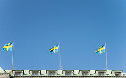 Swedish national flag. S on a roof top Stock Photo