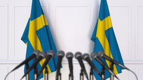 Swedish official press conference. Flags of Sweden and microphones. Conceptual 3D rendering. Swedish official press conference. Flags of Sweden and microphones Stock Image