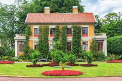 Swedish old vintage national house with flowers in front of it Stock Image