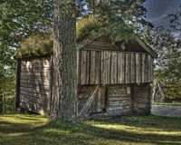 An Swedish old wooden house  from the 1690s  in HDR. The Swedish old wooden house from the 1690s is placed in the open air museum Ramna park's northern part near Royalty Free Stock Images
