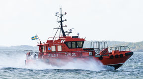 Swedish pilot boat, Pilot 746 SE on the way to the ship, M/T TARNBRIS in the port of Gothenburg Royalty Free Stock Images