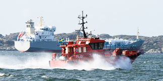 Swedish pilot boat, Pilot 746 SE on the way to the ship, M/T TARNBRIS in the port of Gothenburg royalty free stock image
