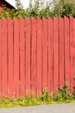 Swedish planks fence. Detail of typical Swedish planks wood fence, with typical red 'falun'  color Royalty Free Stock Image