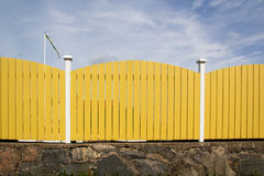 Swedish planks fence. Detail of typical Swedish planks wood fence, with typical yellow  color Stock Photography
