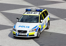Swedish police car. Stockholm, Sweden - June 24, 2014: Swedish police car Volvo V70, vehicle year 2011, parked at Sergel's Torg in Stockholm Stock Photo