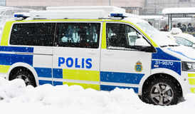 Swedish Police cars parked a winter day when it is snowing outside the main train station, Stockholm central station Royalty Free Stock Image