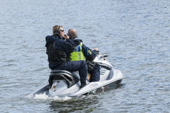 Swedish police watercraft. With two armed officers patrolling slowly. Stockholm, Sweden Stock Images