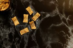 Swedish portion snus snuff in english lies on black marble surface stock photography