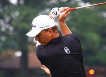 Swedish Pro golfer Robert Karlsson. Prepares to hit the ball at the country clubs PGA golf event Stock Photo