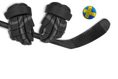 Swedish puck, gloves and hockey stick Stock Images