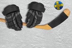 Swedish puck, stick and gloves Stock Photos